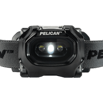 The Pelican 2745 explosion proof headlamp attached to a construction helmet using the 2748 adhesive adapter